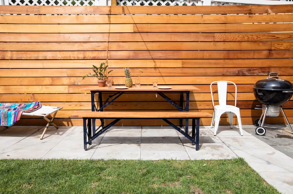 Image of a backyard with new cedarwood walls and picnic table
