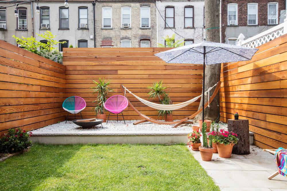 Image of a Brooklyn backyard remodel with cedar wood walls